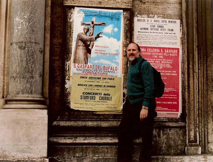 Bill in front of Rome poster